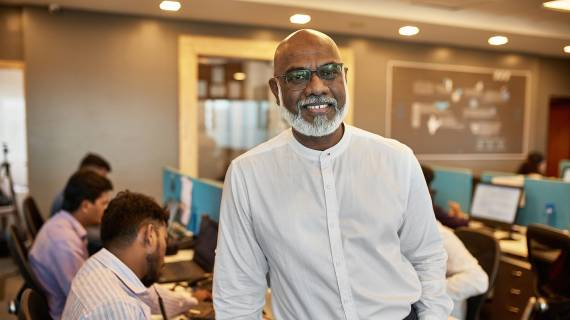 Business man with beard smiling in office