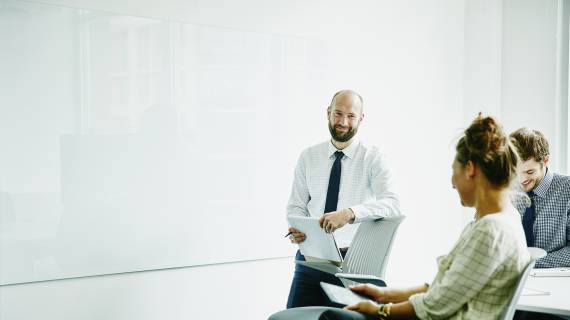 Man presenting in business meeting