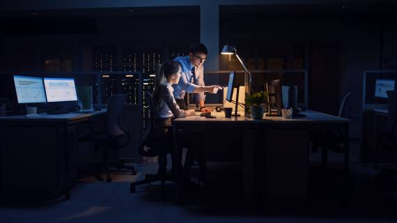 Two people in front of computer