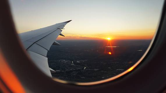 View of sunset and wing from airplane window
