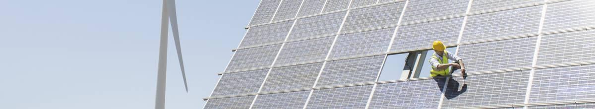 Guy working on solar panels
